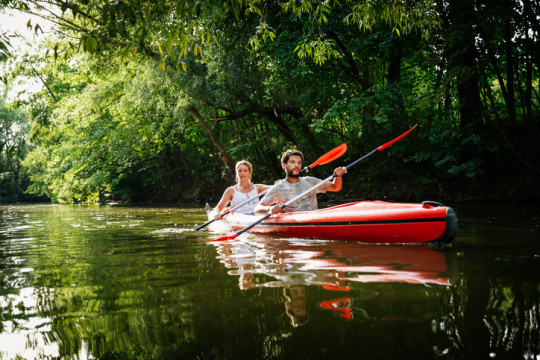 Couple Exploring Canals In Large Kayak Together