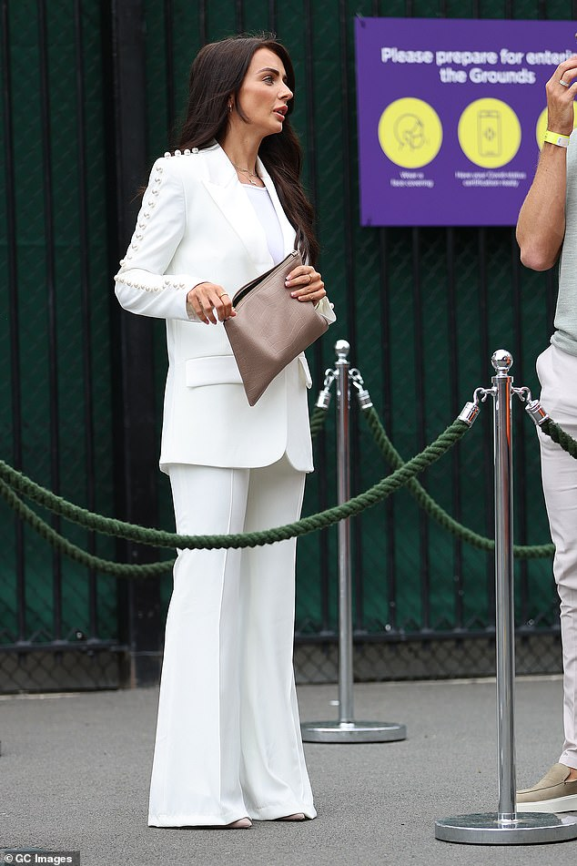 Tennis whites:She matched this with a stone clutch and wore her brunette tresses loosely around her shoulders