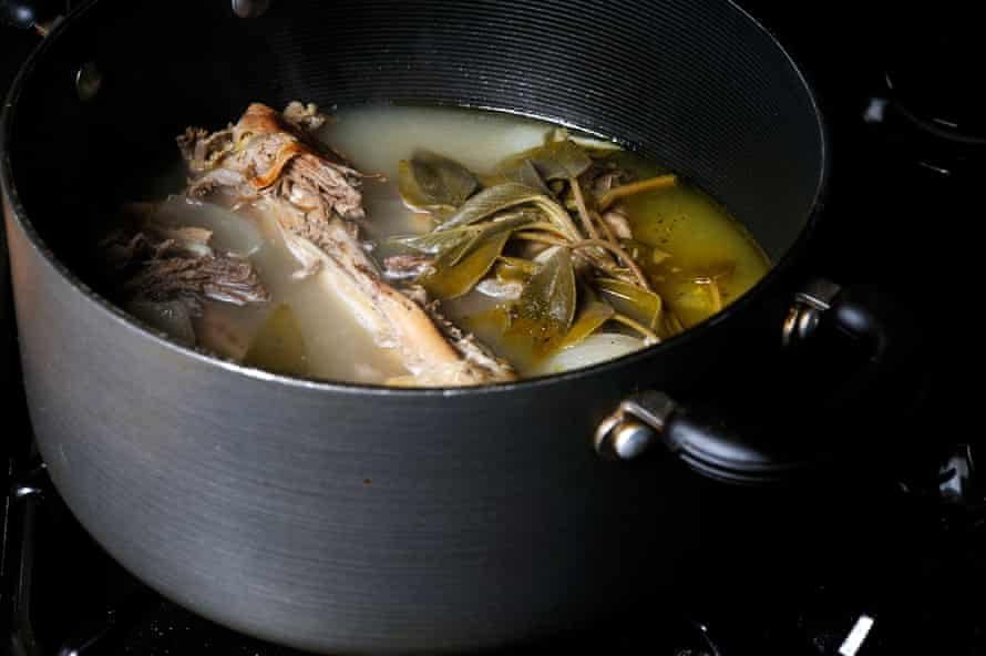 Turkey bones and onions and herbs making a stock