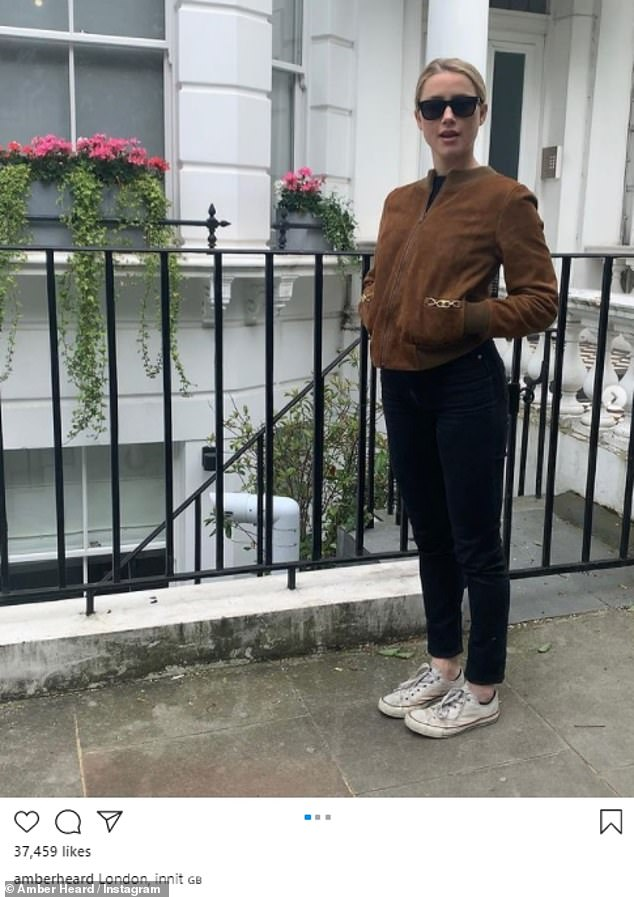 Across the pond: Amber Heard (pictured), 35, shared candid snaps of herself on a London street to Instagram on Monday - after it was reported the highly-anticipated Aquaman sequel would film in the UK