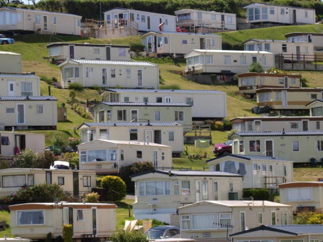 A collection of caravans bathed in sunshine at a Devon caravan park
