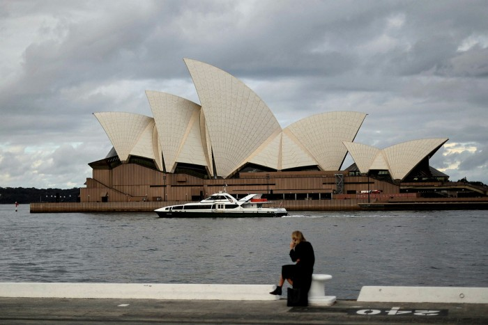 The Sydney Opera House, usually packed with locals and tourists, is quiet as a new outbreak worries the city