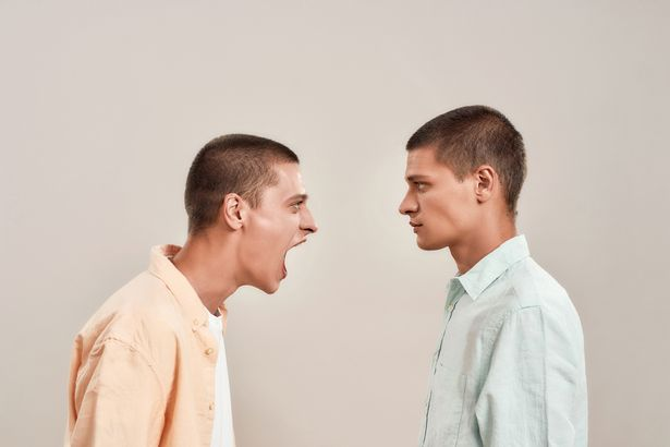 men screaming at each other arguing