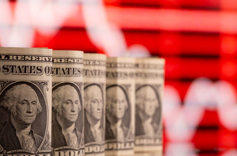 Dollar holds near one-month high; focus on Fed's inflation take