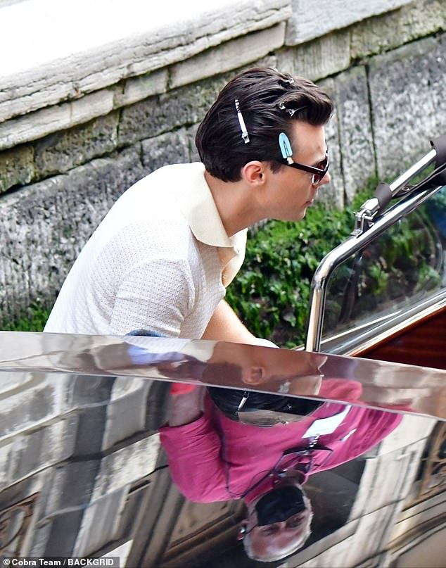 There he is:it was back to work for Harry Styles on Tuesday, who was spotted sporting hair clips in his coiffed locks, as filming recommenced for My Policeman in Venice