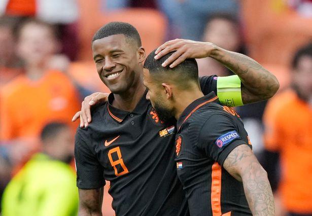 Georginio Wijnaldum celebrates scoring the Netherlands' second after being set up by Memphis Depay