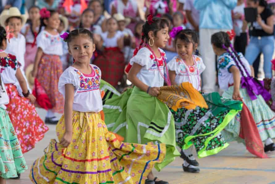 Children in traditional dress in Oaxaca, Mexico.