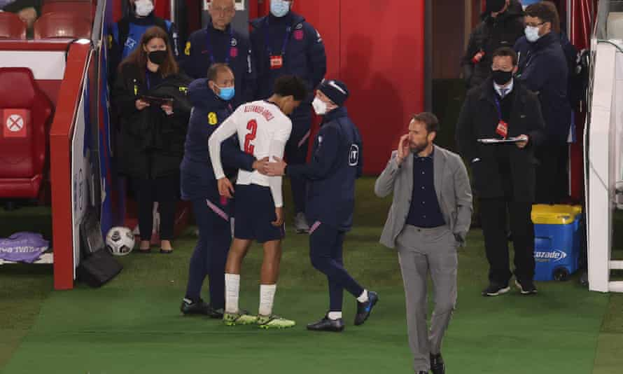 Trent Alexander-Arnold is helped off the pitch after picking up a late injury