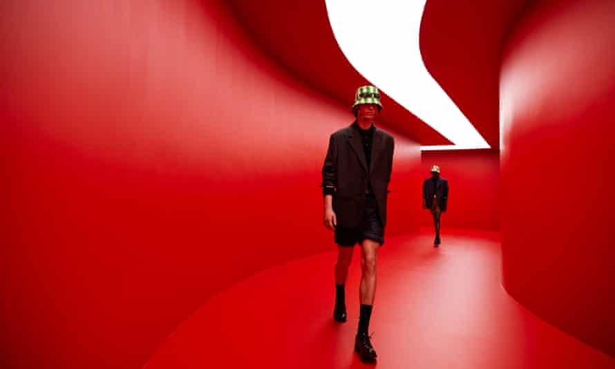 Models walking in the 'tunnel-like underground club-cum-runway lit in devilish red'