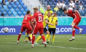 Poland's Robert Lewandowski heads at goal.