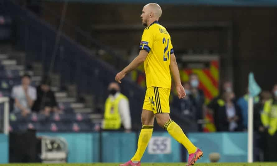 Sweden's Marcus Danielson leaves the pitch after he was shown the red card for his challenge on Ukraine's Artem Besyedin in extra time.