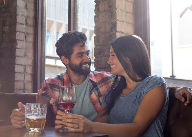 Happy couple sitting in bar on a date.