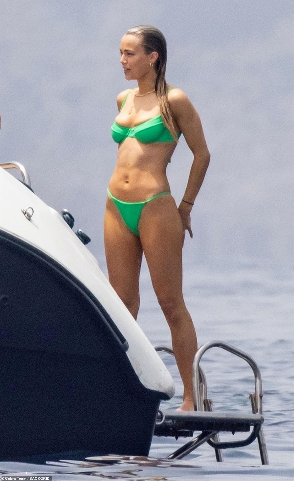 Stunning:Rebecca meanwhile looked stunning as she slipped into a jade green bikini which perfectly showed off her toned figure