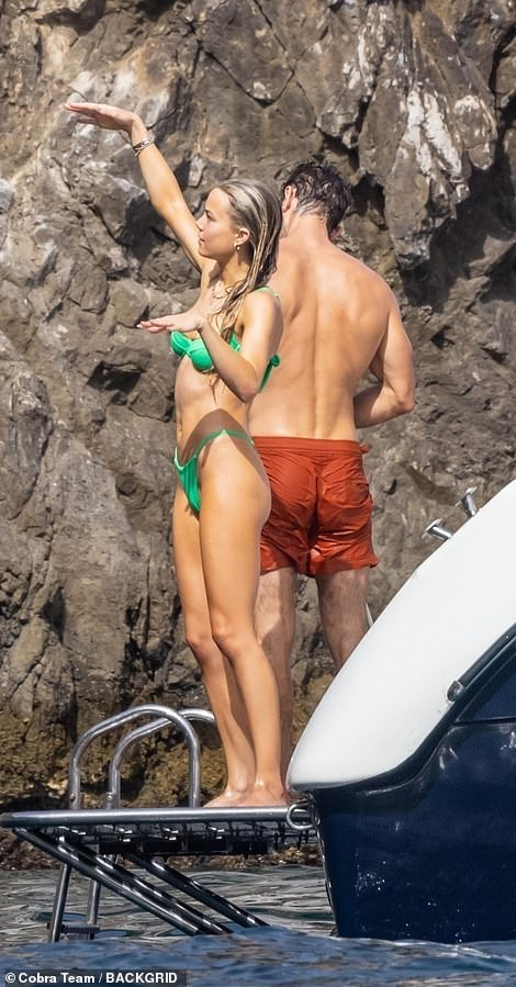 Fun times: Rebecca flung her arms up in the air as she made the most of her time on the boat with Chace