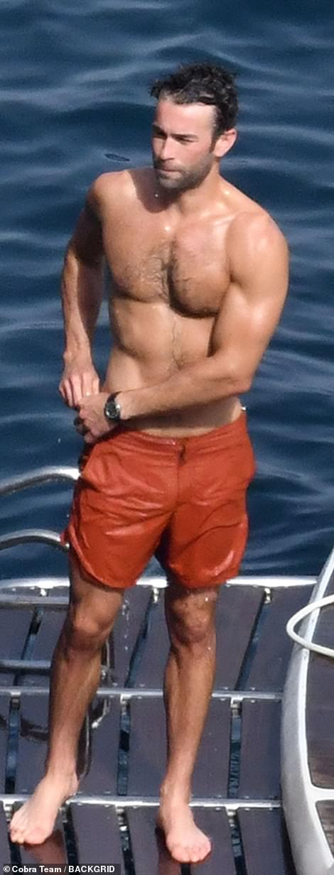 What a sight: Chace was sure to turn heads as she displayed his buff physique in burnt orange shorts