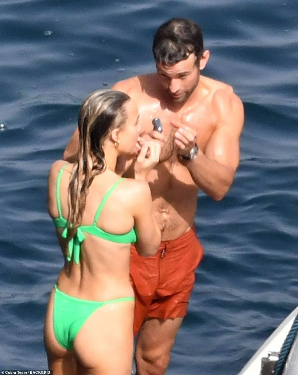 Closer than ever: The duo shared a humorous moment following Chace's dip in the sea