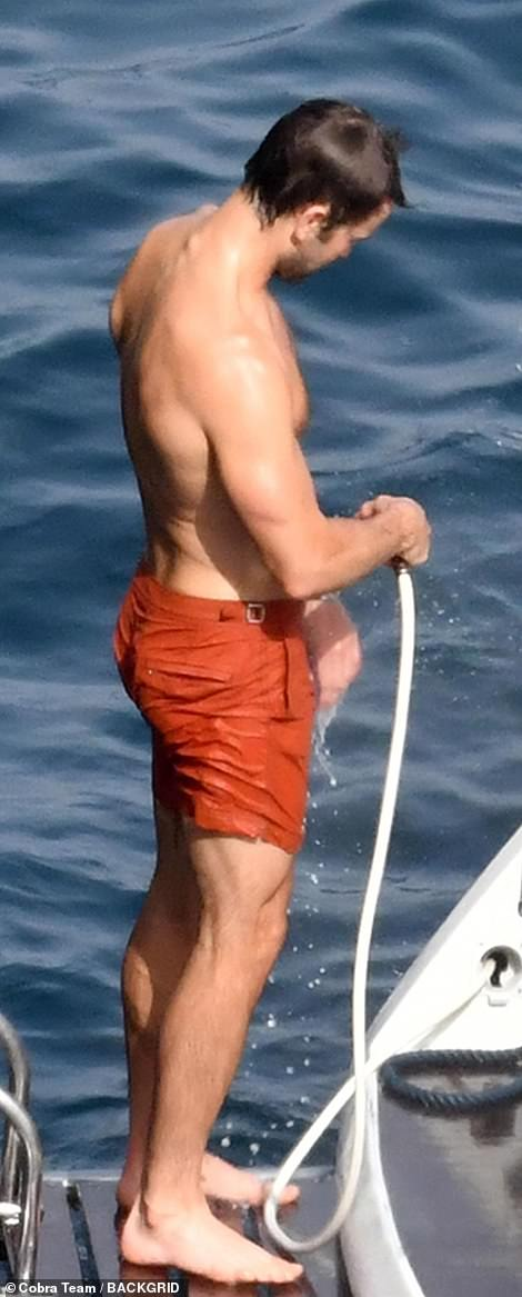 Cooling off: The hunk ensured he rinsed off thoroughly