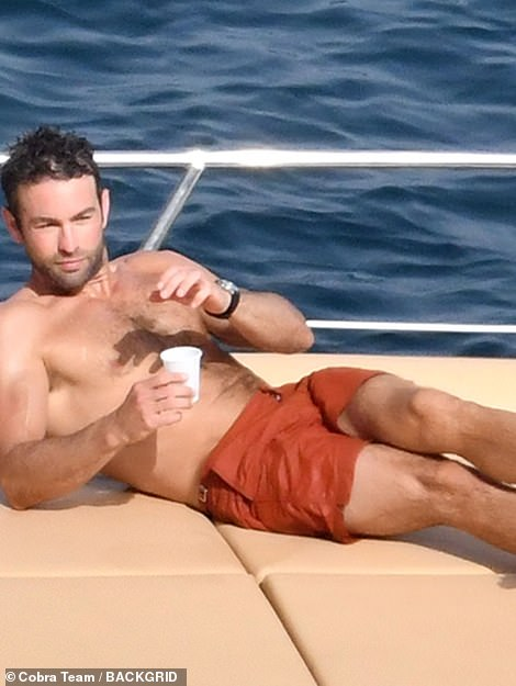 Smooth operator: Chace looked every inch a heartthrob as he lay down on the vessel