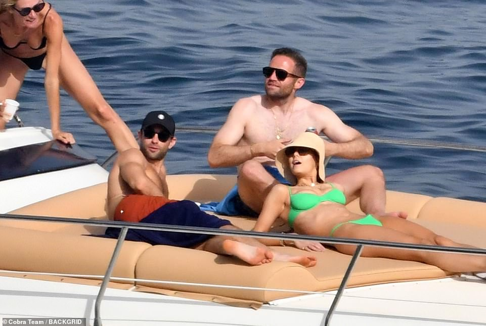 At peace: The group were in a great mood as they took the time to unwind while at sea