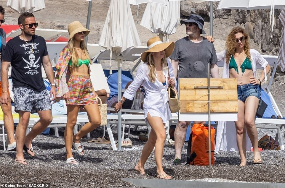 Outing:They were also seen strolling on the beach, with Rebecca at that point donning a colourful shorts and shirt set over her swimwear