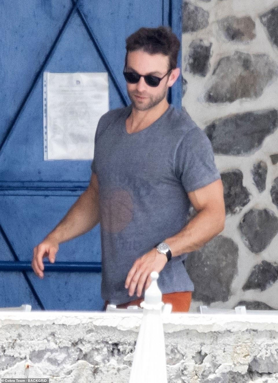 Casual attire:Meanwhile, Chace wore a simple grey T-shirt and dark sunglasses
