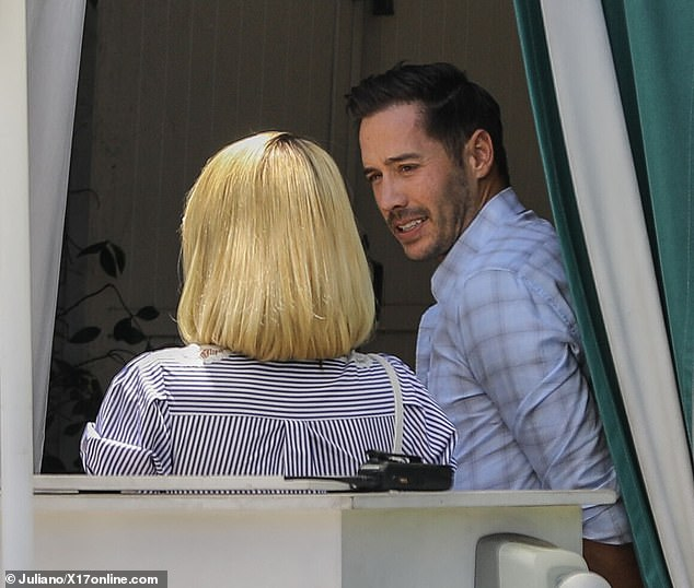 Item: Hilton was later seen chatting it up with her fiance during their lunch date