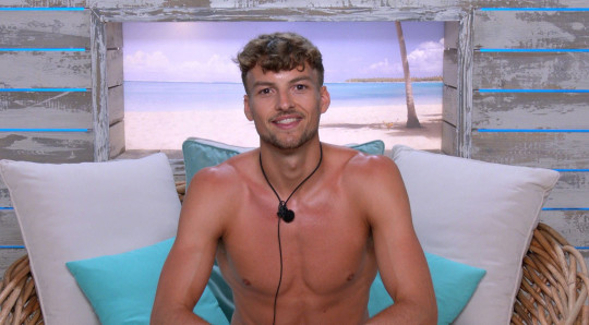 Editorial Use Only. No Merchandising. No Commercial Use. Mandatory Credit: Photo by ITV/Shutterstock (12172583s) Hugo Hammond 'Love Island' TV show, Series 7, Episode 1, Majorca, Spain - 28 Jun 2021 - The Islanders Arrive at the Villa and Couple Up for the First Time. - A Game of Dares is Interrupted by a Late Arrival.