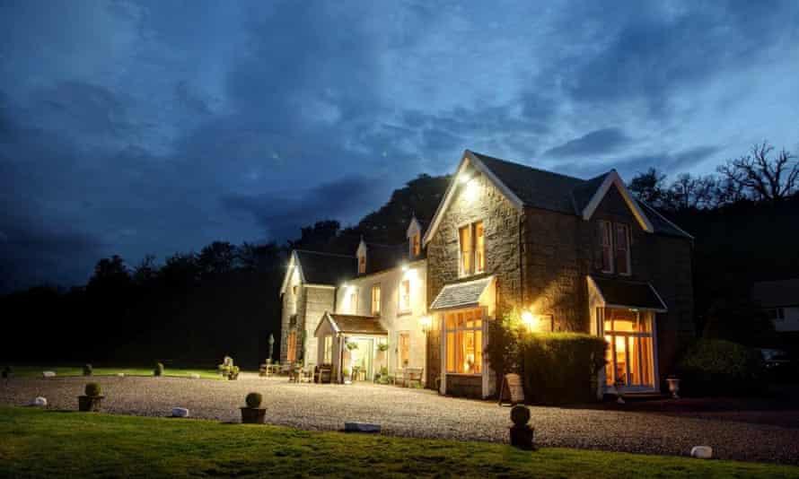 Kilcamb Lodge Hotel lit up at night