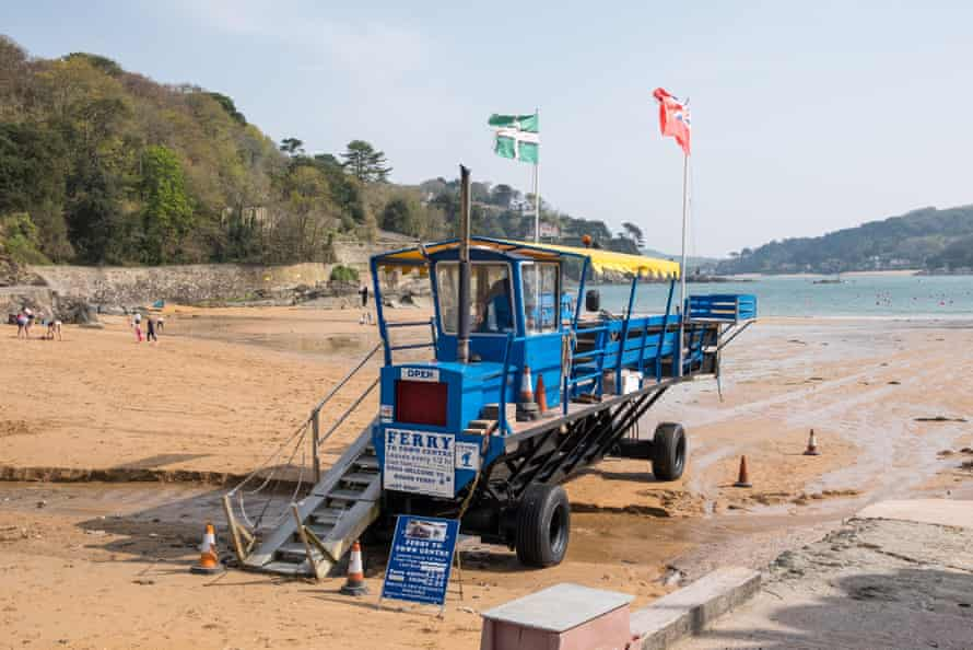 The sea tractor carries passengers from the beach at South Sands to the ferry to Salcombe in South Hams, Devon, UK