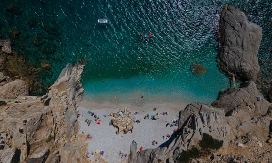 Swimmers and sunbathers at 'Seychelles' in the island of Ikaria, Greece