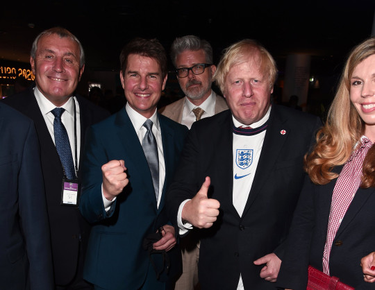 LONDON, ENGLAND - JULY 11: Peter Shilton, Former England International, Actor Tom Cruise, Film Director Christopher McQuarrie, Boris Johnson, Prime Minister of the United Kingdom and wife, Carrie Johnson pose for a photograph prior to the UEFA Euro 2020 Championship Final between Italy and England at Wembley Stadium on July 11, 2021 in London, England. (Photo by Eamonn McCormack - UEFA/UEFA via Getty Images)