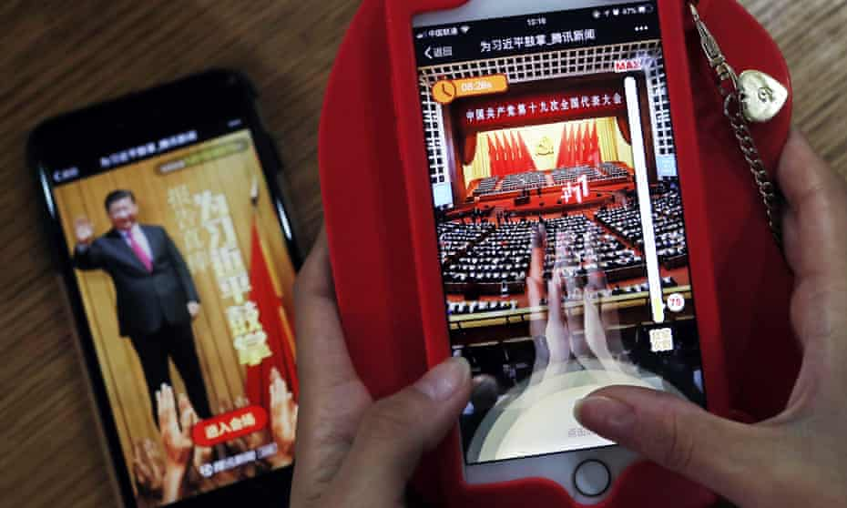 A woman plays Tencent's smartphone game A Great Speech, Clap for Xi Jinping in 2017.