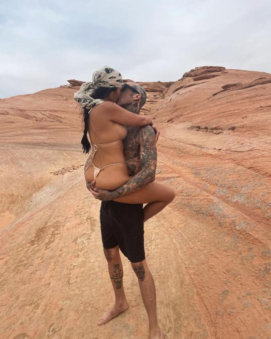 Kourtney Kardashian and Travis Barker kissing in the desert