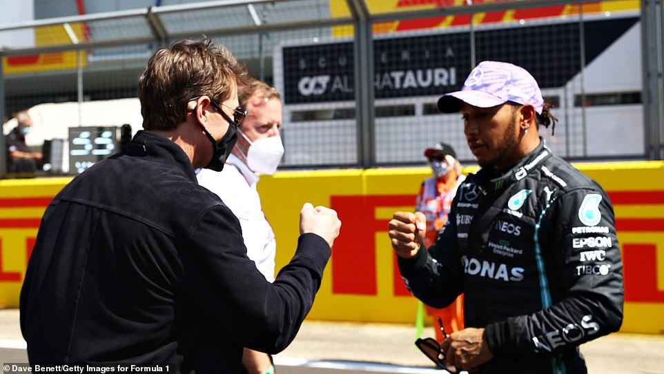 When stars collide: The 59-year-old actor met up with racing ace Lewis Hamilton ahead of the Grand Prix