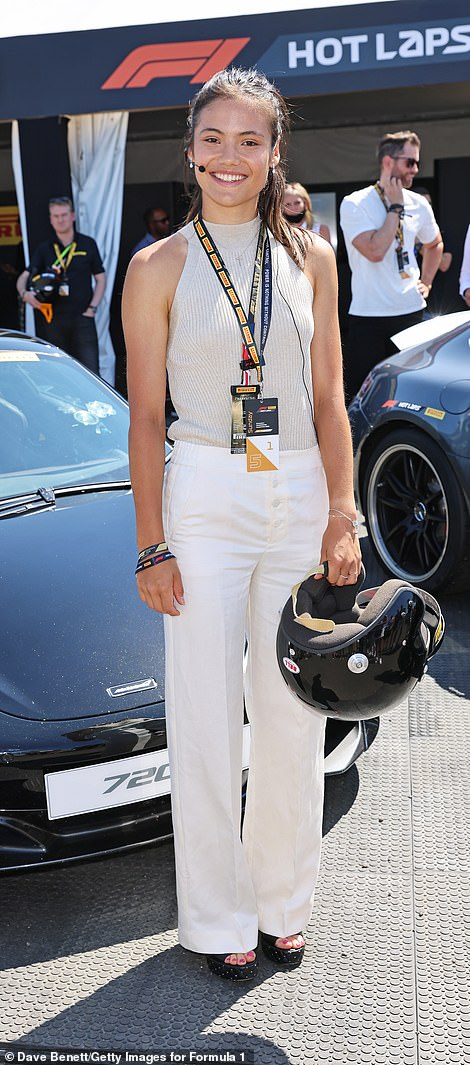 Big smile: The tennis star wore a ridged sleeveless white top paired with a set of white trousers