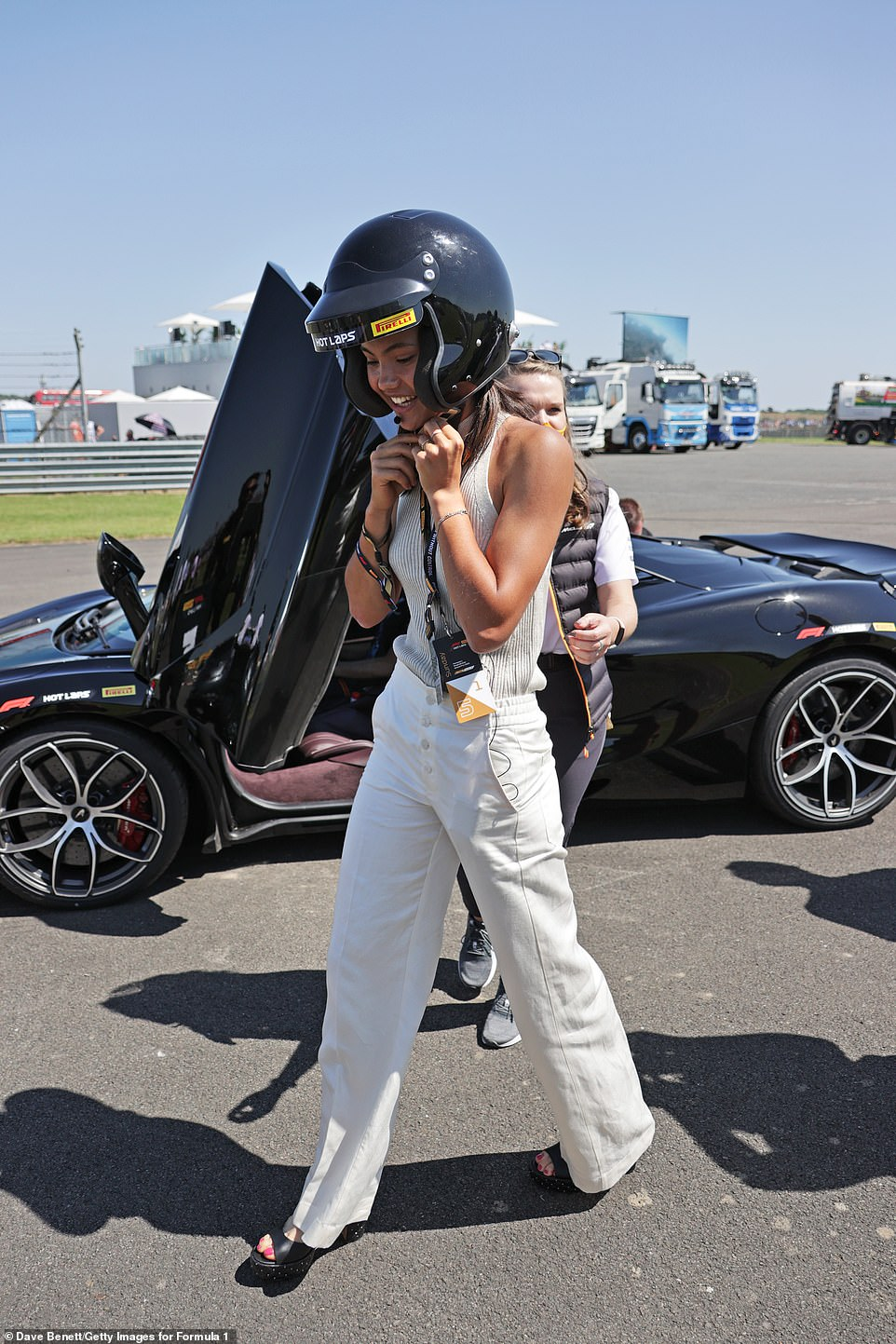 Having fun! On her feet, she wore a pair of chunky black heels and could also be seen with a pair of sunglasses on her head
