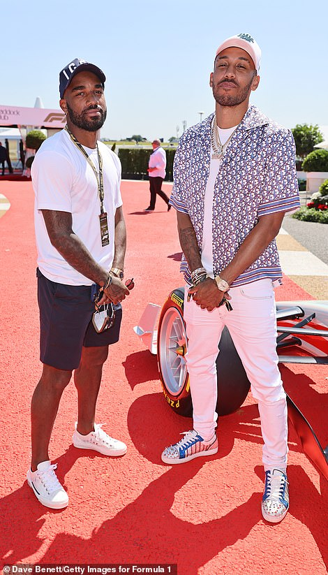 Sharply dressed: In-keeping with the scorching temperatures on the day, the Frenchman (left) sported a pair of navy blue shorts on his lower half and a pair of white canvas trainers