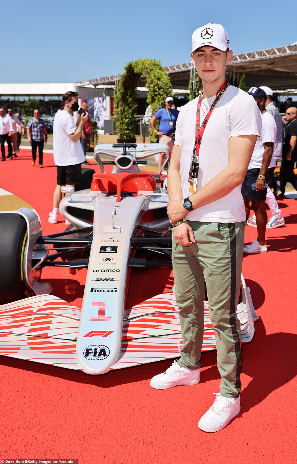 Serious pose: Hero did his best to contain his excitement as he posed next to one of the Formula 1 motors at Silverstone