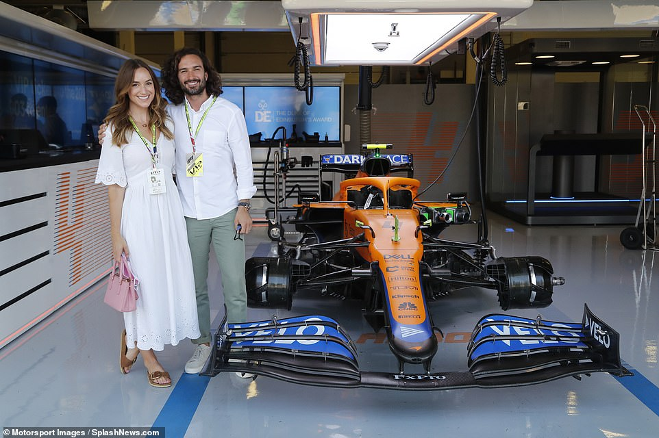 Behind the scenes: Fitness guru Joe Wicks, 34, was also spotted receiving a tour of the garages at Silverstone on Sunday