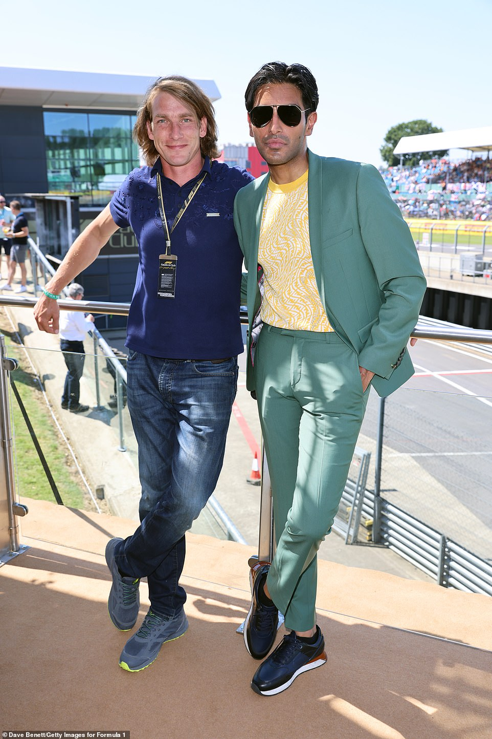 Meeting up:The model even found the time to meet up with racer Freddie Hunt for a photo together