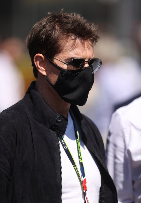 Formula One F1 - British Grand Prix - Silverstone Circuit, Silverstone, Britain - July 18, 2021 Actor Tom Cruise is seen at Silverstone before the start of the race Pool via REUTERS/Lars Baron