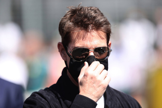NORTHAMPTON, ENGLAND - JULY 18: Tom Cruise looks on from the grid before the F1 Grand Prix of Great Britain at Silverstone on July 18, 2021 in Northampton, England. (Photo by Lars Baron/Getty Images)