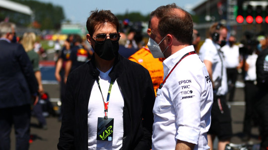 NORTHAMPTON, ENGLAND - JULY 18: Tom Cruise looks on from the grid before the F1 Grand Prix of Great Britain at Silverstone on July 18, 2021 in Northampton, England. (Photo by Dan Istitene - Formula 1/Formula 1 via Getty Images)