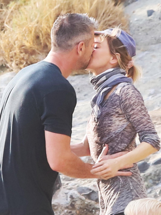 PREMIUM EXCLUSIVE: Don't walk away Renee! Renee Zellweger looks mesmerized as she passionately kisses new boyfriend Ant Anstead while catching the sunset together. The inseparable couple packed on the PDA as they made out during a romantic stroll together. They looked head over heels as they strolled together in Newport Beach, CA. Ant's son Hudson could be seen looking at the ocean as the couple kissed and Renee was later seen talking to him. Bridget Jones s Diary star Renee, 52, and the Wheeler Dealers presenter, 42, took their relationship public after the English presenter recently finalized his divorce from ex-wife, Flip Or Flop star Christina Haack, 38. She is now dating Joshua Hall and have been to Mexico for a romantic break. Christina and Ant are reportedly sharing legal and physical custody of their son. 17 Jul 2021 Pictured: Renee Zellweger , Ant Anstead. Photo credit: APEX / MEGA TheMegaAgency.com +1 888 505 6342
