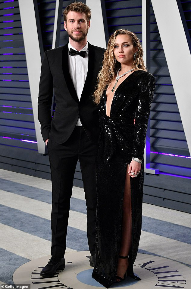The way they were:Miley has been involved with both men and women as with her brief marriage to Liam Hemsworth whom she is pictured with at the Vanity Fair Oscar Party in 2019