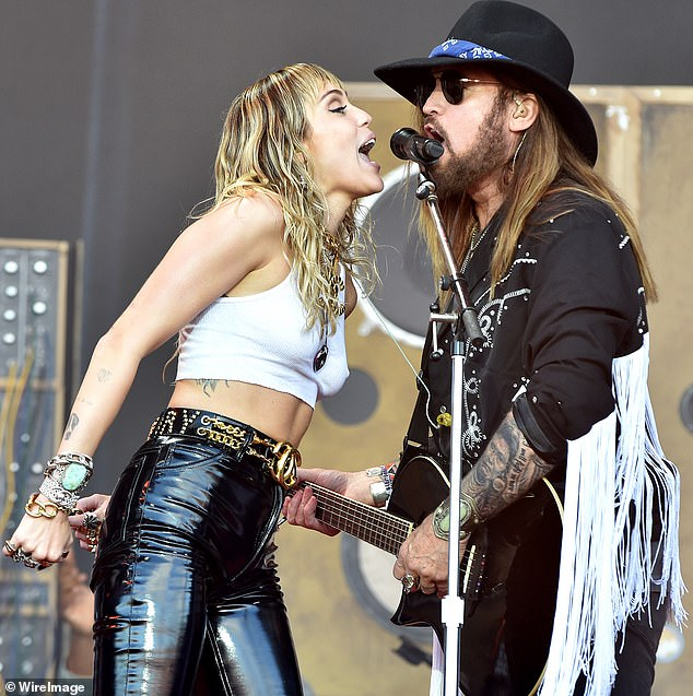 Still singing together: Billy Ray and Miley are pictured performing onstage at England's world-famous Glastonbury Festival over the summer of 2019