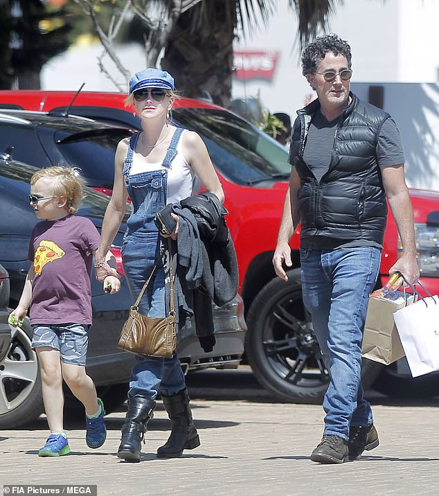 Modern family: Anna is seen with Michael and her son Jack above in May 2019