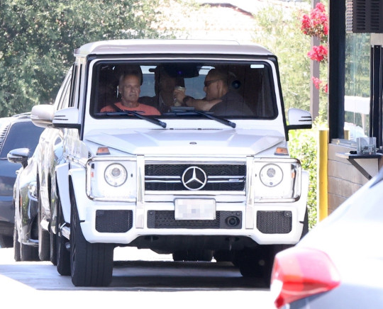 Britney Spears is driven to Starbucks in Westlake by a new security team.
