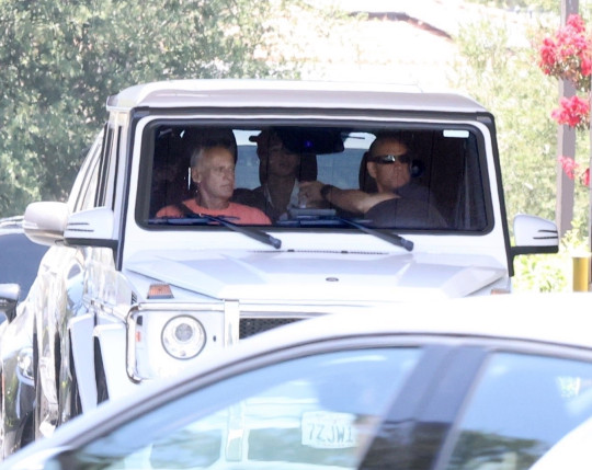 Britney Spears sits in the back of her Mercedes G Wagonwith new security team