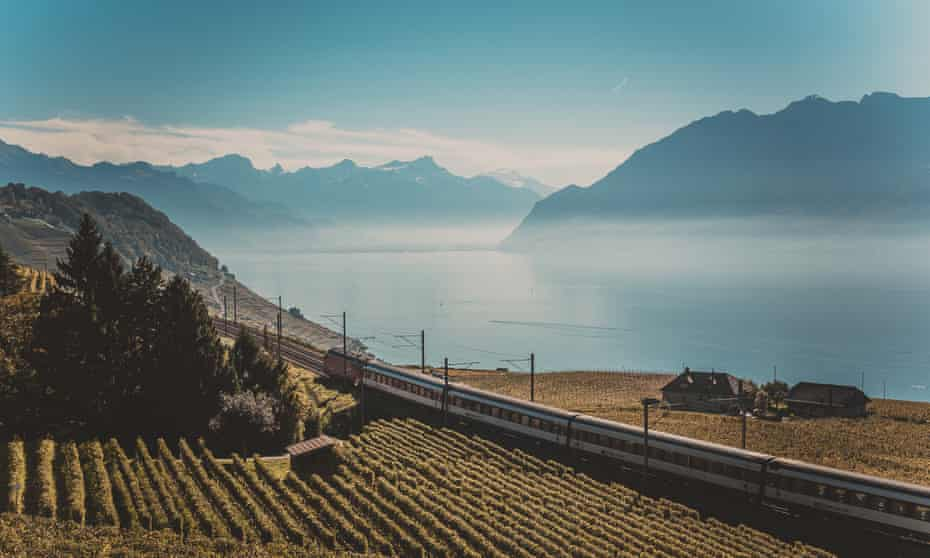 Railroad tracks with train in mountains of Lavaux Vineyard, Switzerland